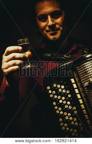 The Chromatic Accordion Player And A Glass Of Alcoholic Beverage.