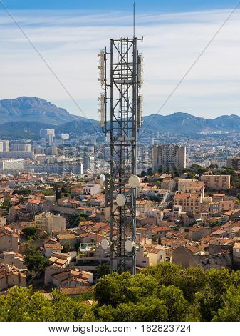 Cell phone tower over a town in southern France