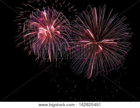 Blue orange colorful fireworks isolated in black background,square photo, fireworks in Malta,fireworks festival,long exposure,fireworks isolated with place for text, Independence day, explode
