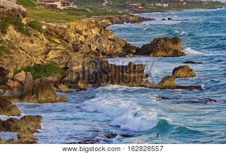 Beautiful rocks at sunrise in Caribbean coast Isla Mujeres Mexico.