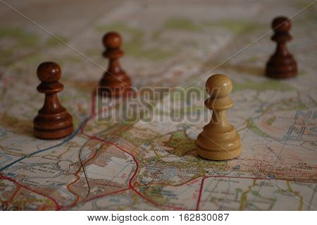 Chess pieces on map depicting strategic planning.