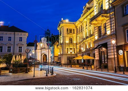 Vilnius, Lithuania - July 8, 2016: Side View Of Lithuanian National Philharmonic Society Building In Bright Evening Illumination On Ausros Vartu Street In Summer Under Blue Sky
