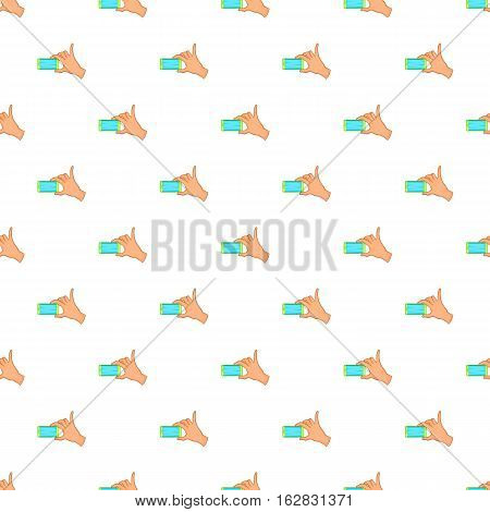 Hand holding mobile phone pattern. Cartoon illustration of hand holding mobile phone vector pattern for web