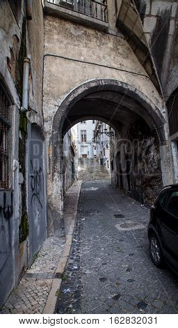 Narrow alleyway and corridor in Lisbon Portugal