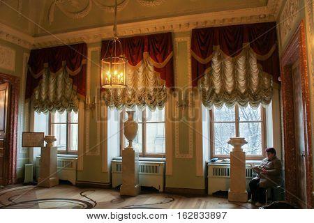 Gatchina, Russia - 3 December, Museum employee at the window, 3 December, 2016. Visit the Museum Reserve Gatchina Palace.