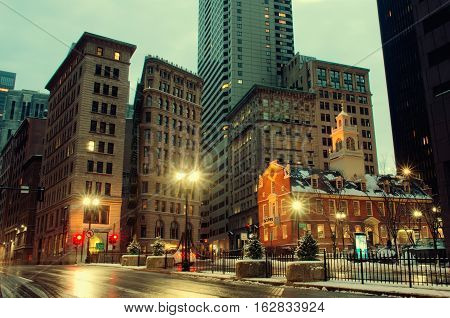 Boston MA USA - December 17 2016: Old State House and the skyscrapers of the Financial District at night in Boston Massachusetts USA