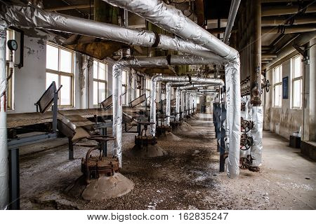 Abandoned old steam bricks boilers network in factory