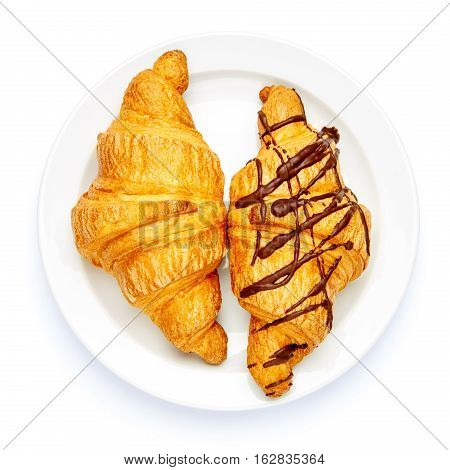 studio shot of two fresh croissants isolated on white background