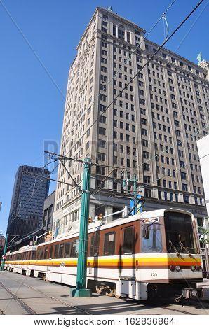BUFFALO, NY, USA - JULY 22, 2011: Buffalo Metro Rail in front of Liberty Building, Buffalo, New York, USA.