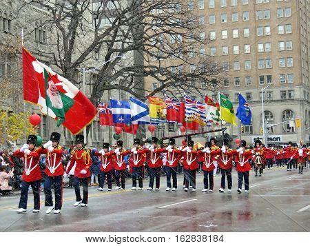 Toronto Canada - November 20 2016: Flag bearers on the Santa Claus Parade.