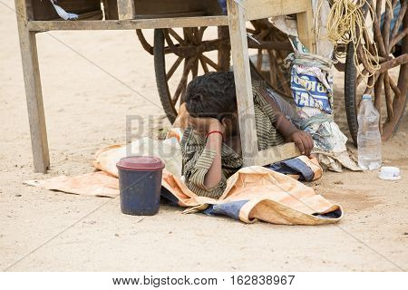 Illustrative image. Pondicherry Tamil Nadu India - July 03 2014. Poor man worker in small village very hard work for little money roupies