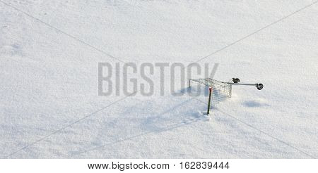 grocery cart on winter snow field, unusual winter landscape
