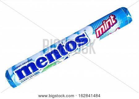 LONDON UK - OCTOBER 13TH 2016: An unopened pack of Mint Mentos over a plain white background on 13th October 2016. The Mentos brand is owned and produced by the Perfetti Van Melle corporation.