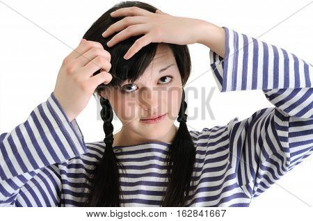 confused young brunette woman touching her hair isolated on white background