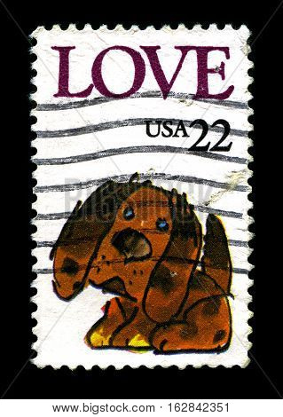 UNITED STATES OF AMERICA - CIRCA 1986: A used postage stamp printed in America portraying LOVE and an illustration of a puppy circa 1986.