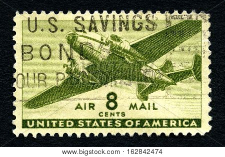 UNITED STATES OF AMERICA - CIRCA 1944: A used Air Mail postage stamp from the United States of America picturing a transport aircraft circa 1944.