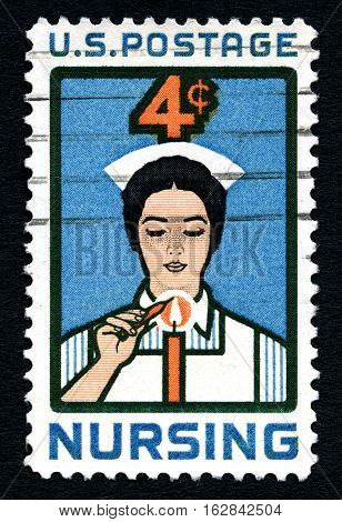 UNITED STATES OF AMERICA - CIRCA 1961: A used postage stamp from the United States of America dedicated to the profession of Nursing circa 1961.