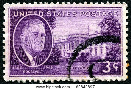 UNITED STATES OF AMERICA - CIRCA 1945: A used postage stamp in memory of President Franklin D Roosevelt and portrayed with an image of the White House circa 1945.