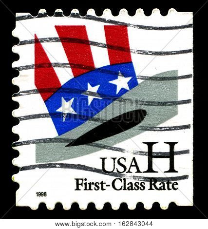 UNITED STATES - CIRCA 1998: A used postage stamp from the United States of America featuring an illustration of Uncle Sam's top hat circa 1998.