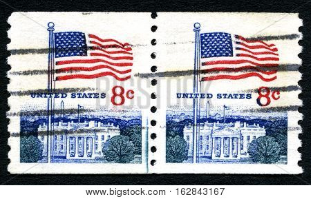 UNITED STATES OF AMERICA - CIRCA 1971: A used postage stamp from the USA depicting an illustration of the White House and the American flag circa 1971.