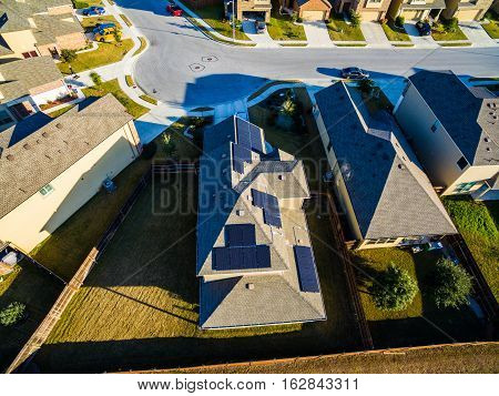 Sunset Suburban Homes North of Austin near Round Rock. Texas expands more and more homes are built in Modern Neighborhood Communities One House with Solar Panels providing clean renewable energy