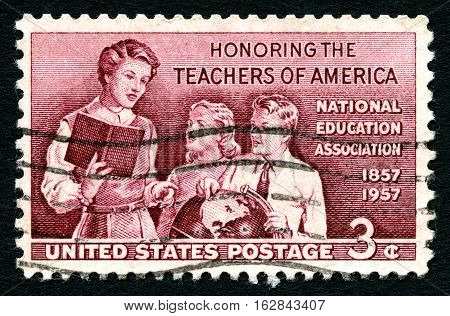 UNITED STATES OF AMERICA - CIRCA 1957: A used postage stamp from the USA Honoring the Teachers of America circa 1957.