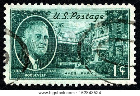 UNITED STATES OF AMERICA - CIRCA 1945: A used posted stamp from the USA depicting an illustration of President FD Roosevelt and his Hyde Park home circa 1945.