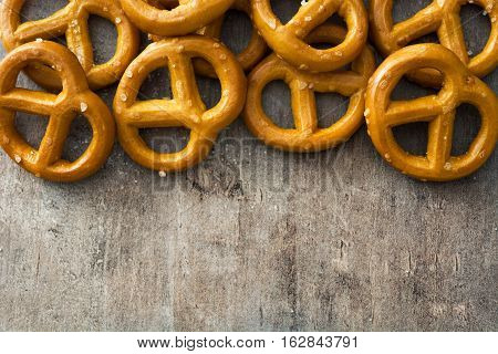 Salted pretzels snack on wooden table background