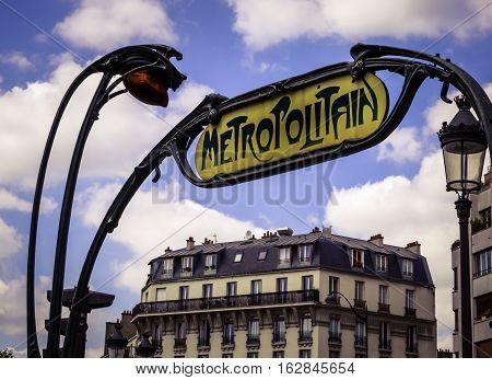 PARIS, FRANCE - MAY 17, 2016: This Metropolitan sign directs travellers to one of Paris's underground rapid travel rail stations. There are over 300 stations in the City's greater metropolitan area.