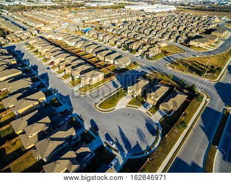 Sunset Suburban Homes North of Austin Texas USA New Development with rows and rows of Cookie Cutter Houses