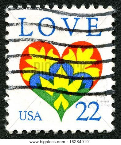 UNITED STATES OF AMERICA - CIRCA 1982: A used postage stamp from the US celebrating Love and depicting a colourful illustration of a heart circa 1982.
