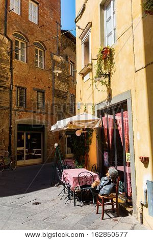 Small Restaurant In An Alley In Lucca, Tuscany, Italy