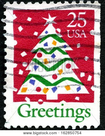 UNITED STATES OF AMERICA - CIRCA 1990: A used postage stamp from the USA depicting an illustration of Christmas Tree circa 1990.