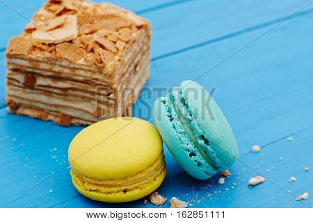 French macaron cookies on a blue wooden table
