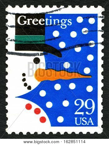 UNITED STATES OF AMERICA - CIRCA 1993: A used postage stamp from the USA wishing Christmas Greetings and an illustration of a Snowman circa 1993.