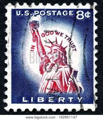 UNITED STATES OF AMERICA - CIRCA 1954: A used postage stamp from the USA celebrating Liberty by depicting an illustration of the Statue of Liberty with the phrase In God We Trust circa 1954.