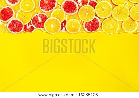 Tasty colorful bright fruity background with oranges and grapefruits. Top view. Healthy life or detox concept. Healthy food.