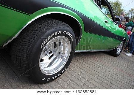 The wheel of Dodge Charger car at motor show, Belarus, Minsk, may, 07.2016: International festival of retro cars