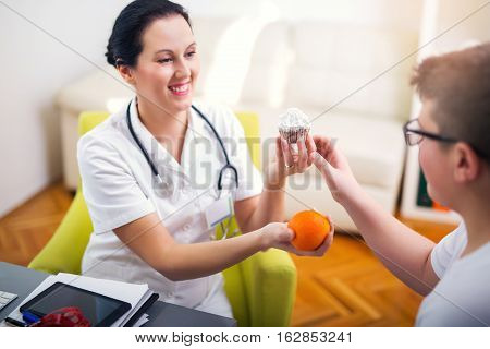 Female doctor nutritionist and teenager male patient