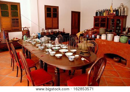 Georgetown Malaysia - January 12 2008: The hoousehold staff dining table in the great kitchen of the 1895 Pinang Peranakan Mansion Museum