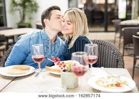 Cute Couple At A Restaurant