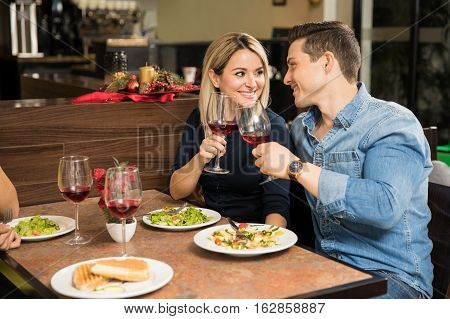Young Couple Making A Toast With Wine