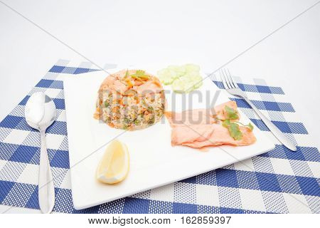 On an plate there is Thai food whit salmon and scampi