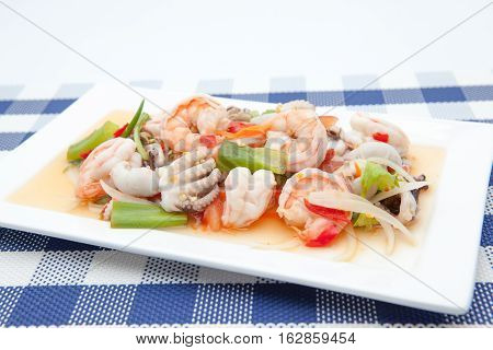 On an plate there is Thai food whit scampi and squid