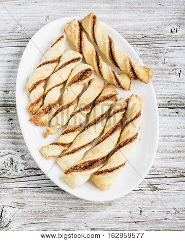 Cozy flavorful baked crispy sticks with cinnamon for tea, snacks, picnic, as a gift for a holiday. Top view. comfort food concept