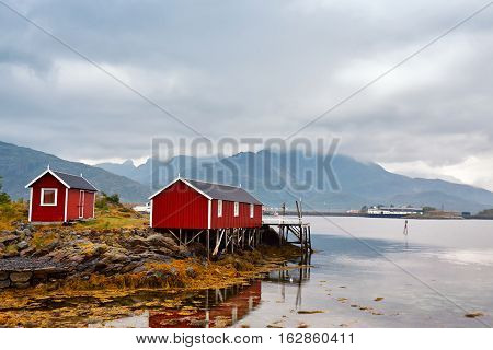 Norwegian Hut Rorbu On Bay Coast. Nordic Cloudy Summer Day.