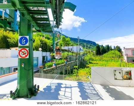 Capri, Italy - May 04, 2014: The people sitting at cableway at Capri island on a beautiful sunny day in Italy on May 04, 2014