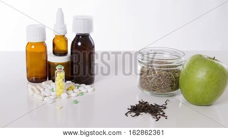 Herbal medicine VS Chemical medicine the alternative health care isolate on white background.