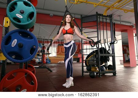 Fitness Woman Workout On The Trx Straps . Fitness In The Gym. Crossfit Woman. Crossfit Style. Crossf