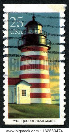 UNITED STATES OF AMERICA - CIRCA 1990: A used postage stamp from the USA depicting an illustration of West Quoddy Lighthouse in Maine circa 1990.